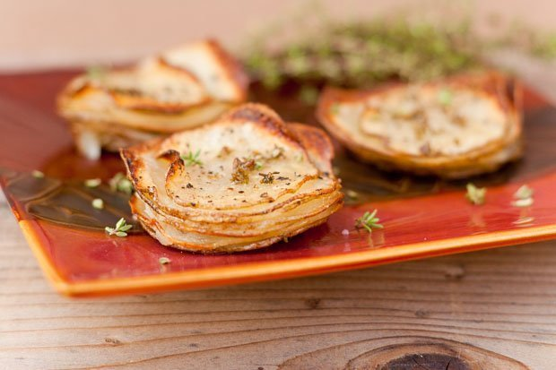 potato stacks as a side dish for Christmas breakfast: These roasted potato stacks are impressive looking and super tasty. They get crispy little edges and a soft, almost creamy center. They're pretty easy to make too. They're great at breakfast, brunch, dinner, heck anytime! #potato #roasted #sideDish