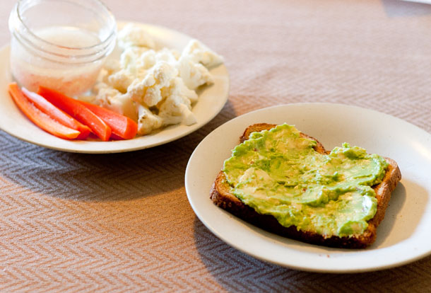 open faced avocado sandwich with veggie plate
