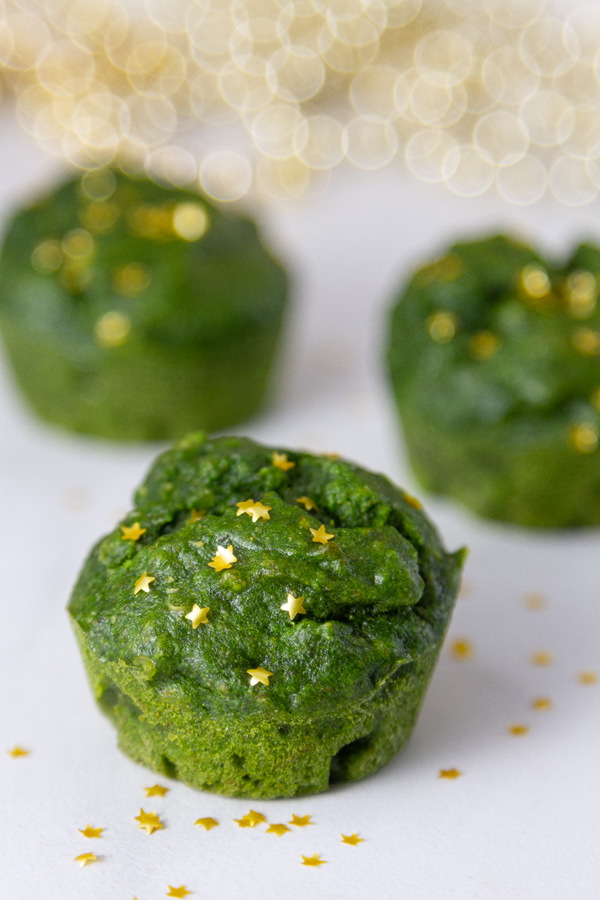 green muffins with gold stars on top