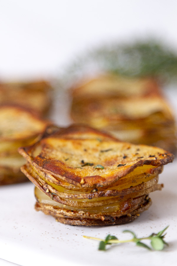 stacked potato slices, baked with fresh herbs.