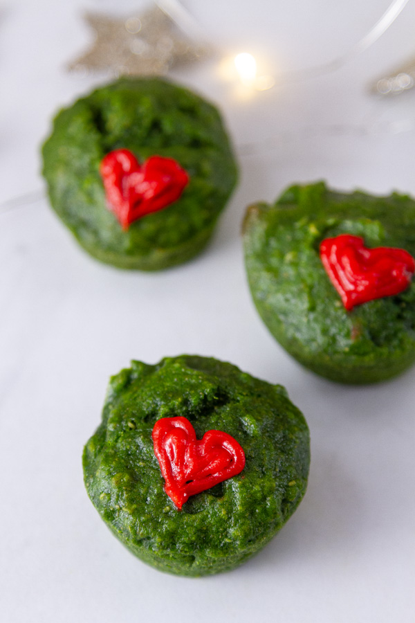 green muffins with red icing hearts.