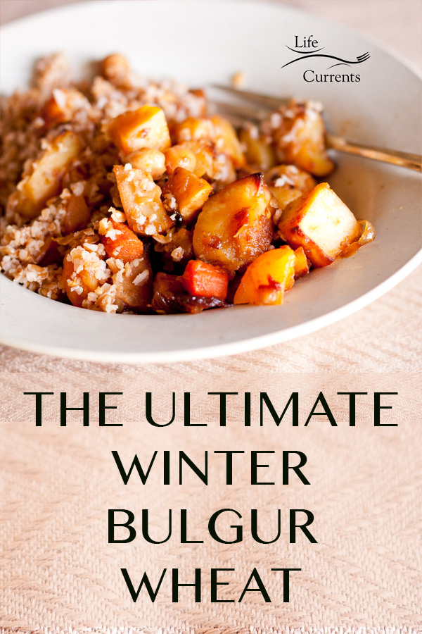 THE ULTIMATE WINTER BULGUR WHEAT in a white bowl with veggies and a fork