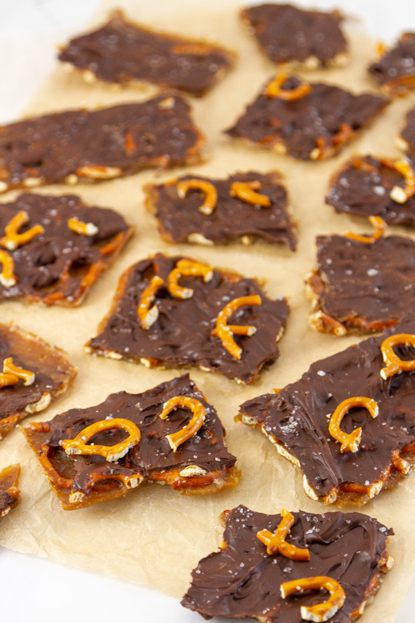 lots of pieces of toffee bark on a sheet or parchment paper.