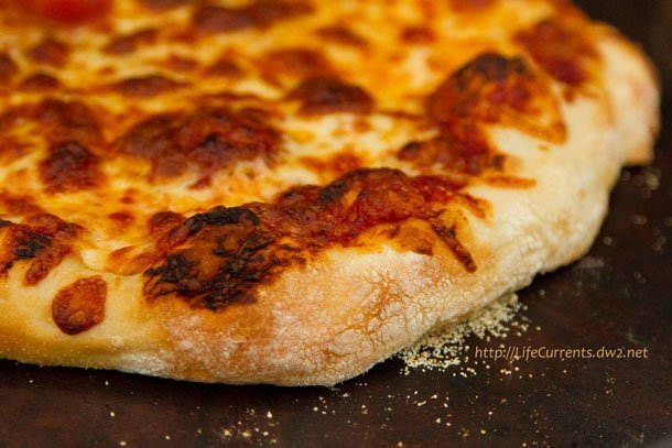 This Homemade Thin Crust Pizza from ATK is da bomb! And, when it's served with my pizza sauce, there's no need to go out to a pizza place. #budget #pizza #thinCrust https://lifecurrentsblog.com