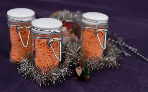 colorful salt in small jars with Christmas decorations.