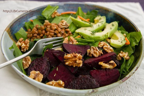 The Farmer's Market Salad with roasted beets, toasted walnuts, lentils, avocado, and thyme on fresh spinach by Life Currents