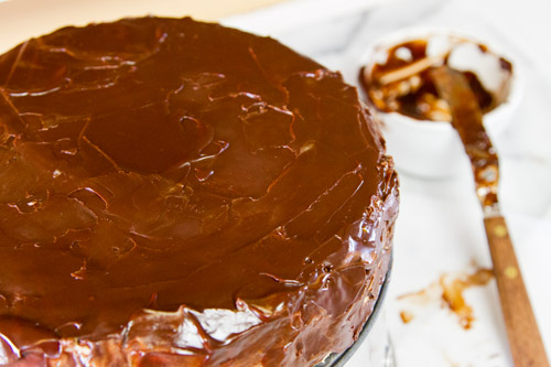 For the glaze: continue glazing and spreading For the Glaze: first application of the glaze, also called the crumb coat For the glaze: removing the plastic wrap Frozen Mocha Cake with Chocolate Ganache Glaze or Birthday Dessert 2013! https://lifecurrentsblog.com