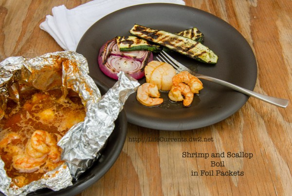 Shrimp and Scallop Boil in Foil Packets | Life Currents https://lifecurrentsblog.com This Shrimp and Scallop Boil in Foil Packets is something we've been playing around with all summer. It makes an easy going dinner party that everyone loves! #seafood #grill #foilPacket