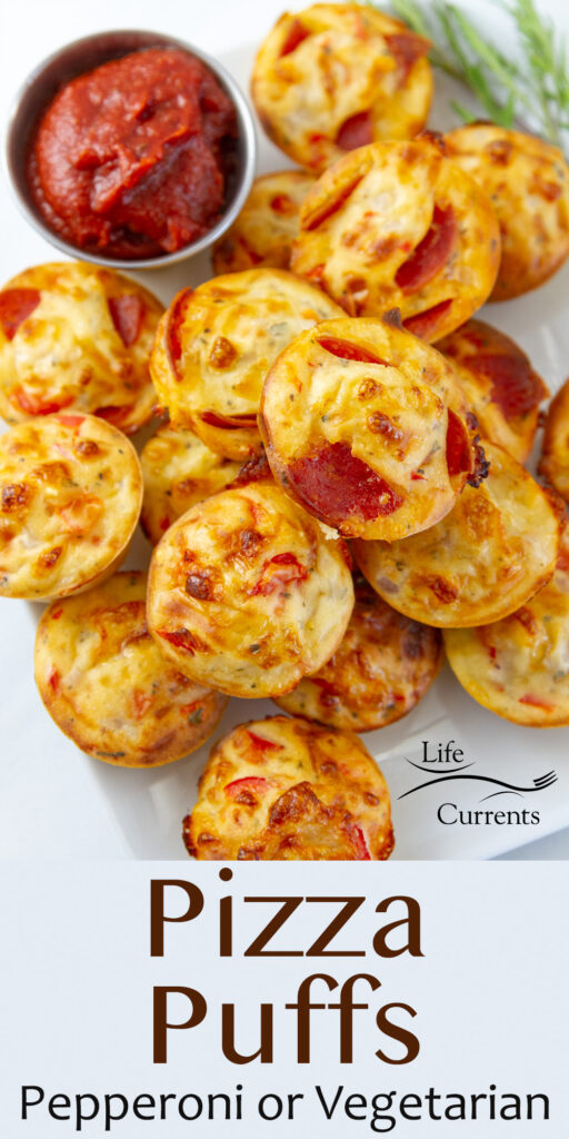 a serving tray filled with appetizer pizza puffs and red sauce to dip them in.