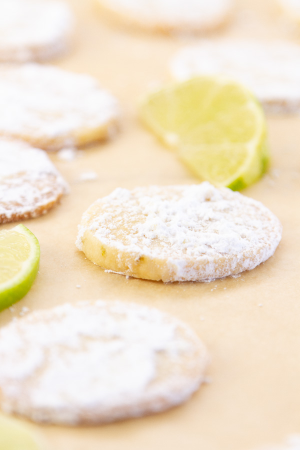 cookies on a baking sheet with some lime slices.