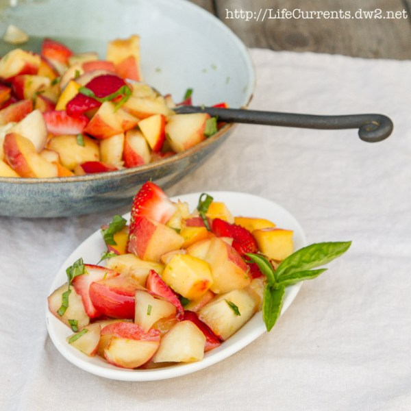 Pineapple Blueberry Fruit Salad in a Pineapple Bowl featured recipe for Peach, Nectarine, and Strawberry Fruit Salad with Lime Honey Basil Syrup