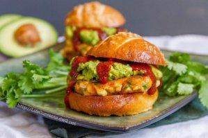 Corn Fritter Sliders with Avocado and Enchilada Sauce on Pretzel Buns | Life Currents https://lifecurrentsblog.com