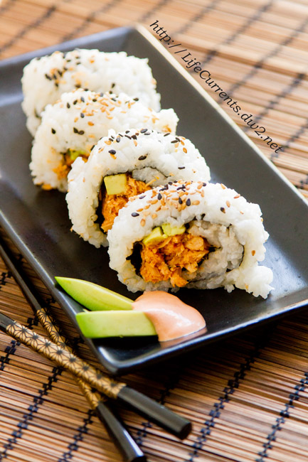 Island Trollers Spicy Tuna Roll, the inside out version. I love making my own sushi at home; it's delicious, better for your budget, and fun! https://lifecurrentsblog.com