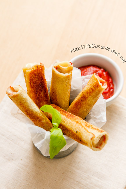Pizza Sticks are a super fun snack to serve at your next tailgate or any party by Life Currents https://lifecurrentsblog.com