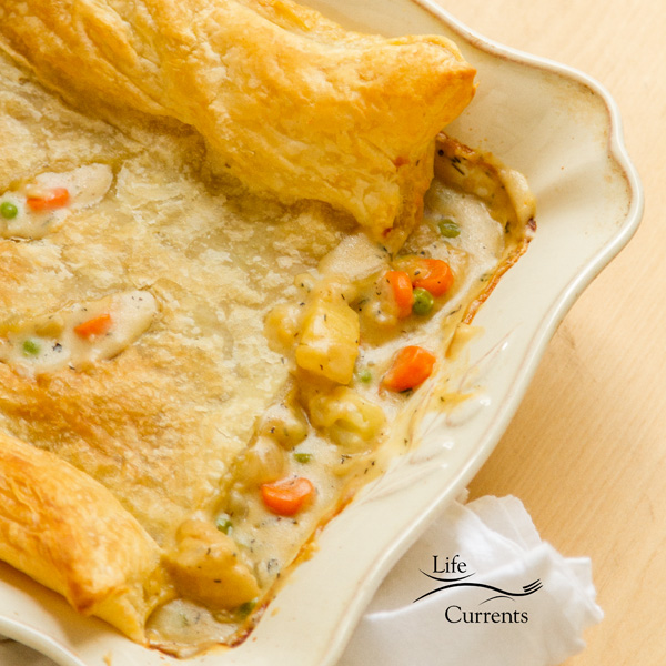 Mom's Vegetarian Pot Pie covered in puff pastry in the casserole dish square crop