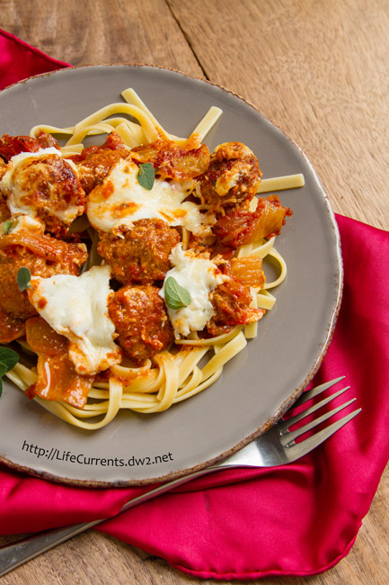 Baked Meatballs in Balsamic Tomato Sauce is a great weeknight meal, easy to make and makes great leftovers. Serve it over pasta or in a hoagie roll for a sandwich!
