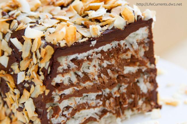 Coconut Chocolate Marjolaine: soft coconut meringue alternates with dark chocolate-rum ganache filling