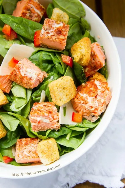 Summer salad featured recipe for Salmon Caesar Salad -- perfect way to use leftover cedar plank grilled salmon. And, talk about good-for-you! Fresh spinach. Fresh salmon. All kinds of goodness going on in this Salmon Caesar Salad!