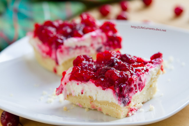 These Cranberry Cheesecake Dream Bars with an Almond Shortbread Crust are amazing. A buttery almond crust topped with a creamy no-bake vanilla cheesecake layer. And all crowned by a festively tart cranberry topping. So lovely. So seasonal. And, great for the holidays.