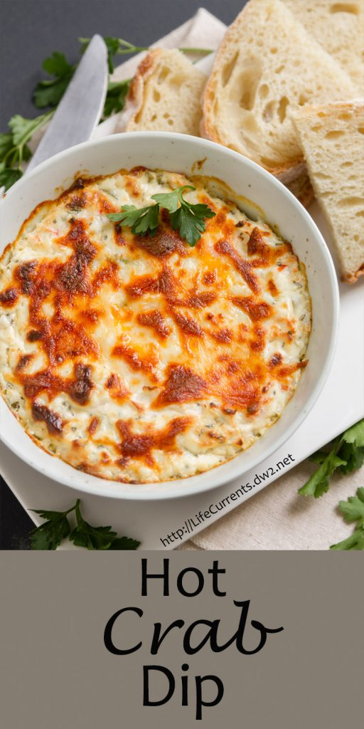 Crab dip in a bowl with some bread slices, title on bottom of image.