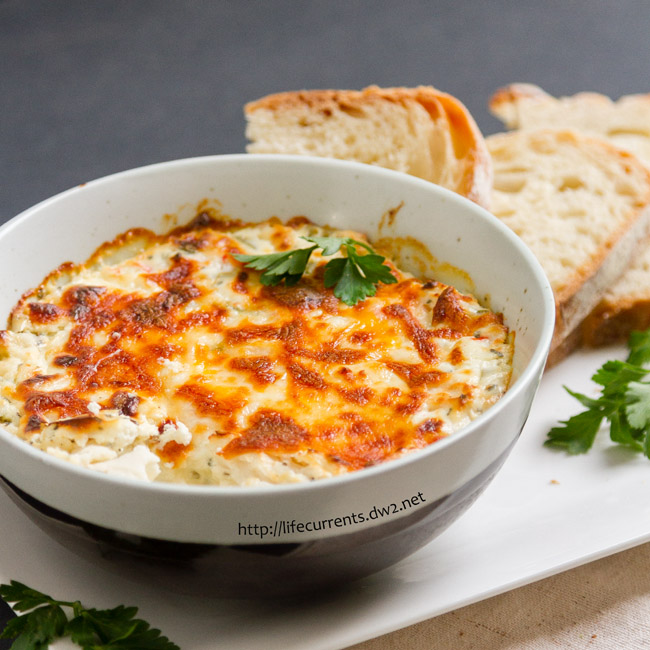 Crab Dip is rich and creamy and makes a delicious appetizer that you can't stop eating!