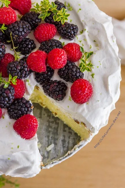 Mother's Day Desserts Fragrant Jasmine Rice Cake - pretty gluten-free celebration cake with its fragrant cardamom and lime scented rice pudding insides all crowned with lime whipped cream and fresh berries - the perfect dessert or breakfast