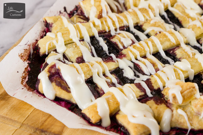 Blueberry Breakfast Pastry filled with cream cheese and yummy wild blueberries and then drizzled with a cream cheese icing! Oh, it's a heavenly way to start the day!
