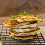 Onion Fritters - All the taste of an onion ring in a simple to make little pancake. Everyone will love these as a side dish or a fancy appetizer.