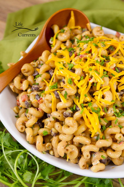 This Loaded Southwestern BBQ Pasta Salad will be a big hit! Black beans, creamy BBQ dressing, all the southwestern veggies! Super yummy.