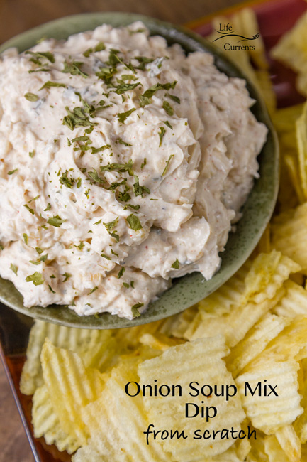 Onion Soup Mix Dip in a green bowl surrounded by potato chips