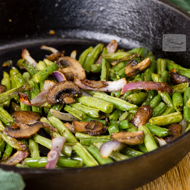 Easy Roasted Green Beans with Mushrooms and Onions in a cast iron skillet square crop