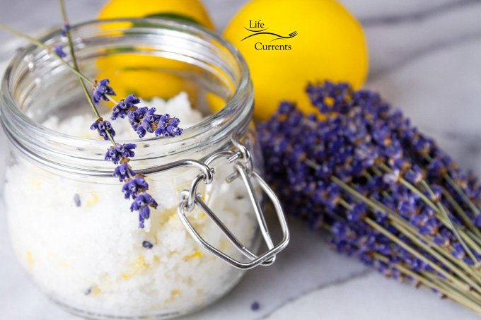 Lavender Simple Syrup Recipe featured recipe for Lemon Coconut Sugar Scrub in a glass jar with lavender flower bundle and lemons