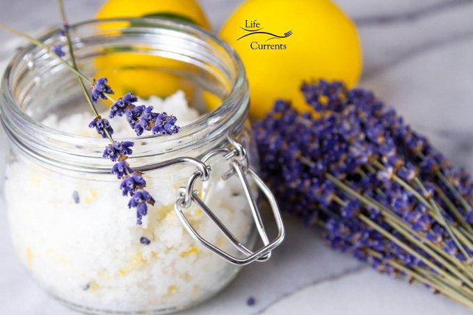 Sugar Scrub in a glass jar with lavender flower bundle and lemons