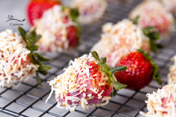 Coconut Dipped Strawberries cooling on a rack