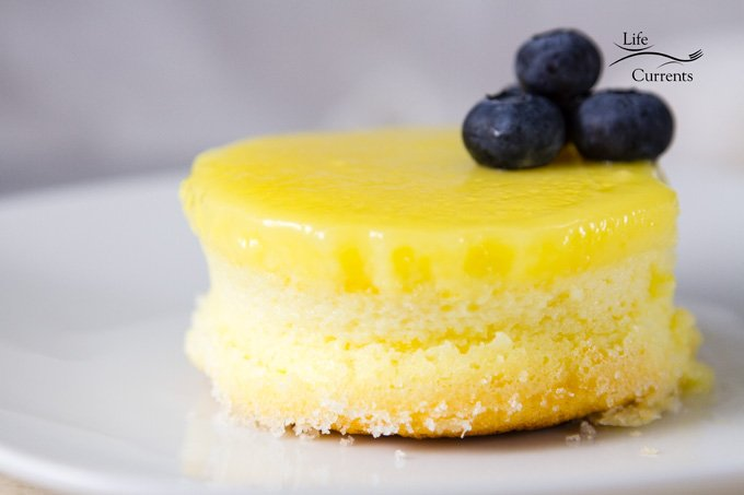 Lemon Soufflé Magic Cakes - airy sponge cakes topped with a lemon curd pudding with fresh blueberries