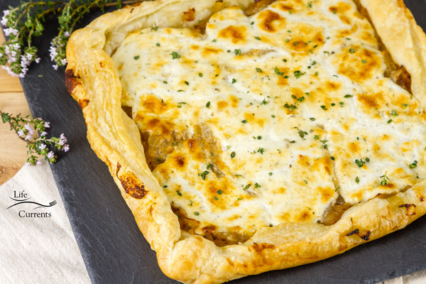 French Onion Tart - Sweet caramelized onions topped with earthy goat cheese, and all baked up in a flaky delicious puff pastry tart.