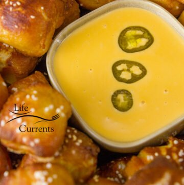 Candied Jalapeno Cheese Sauce - There's just something about rooting on your team during football season that calls for cheesy, gooey, indulgent comfort food, and this jalapeno cheese sauce totally delivers!