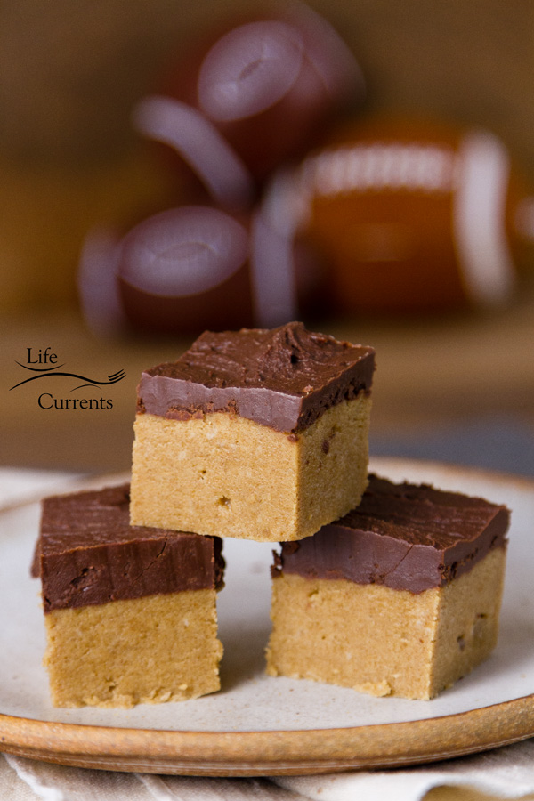 No Bake Peanut Butter Bars are the perfect tailgating snack for a sweet dessert treat. I mean, does it get any better than peanut butter and chocolate together in a simple and easy to make no bake treat!