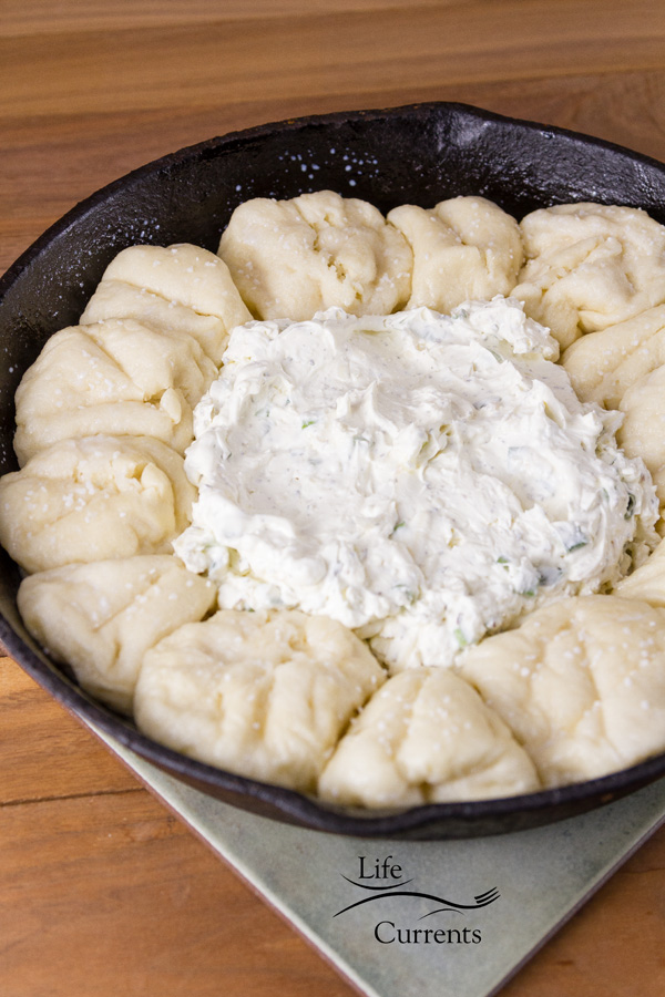 dough balls around cheese dip in a skillet