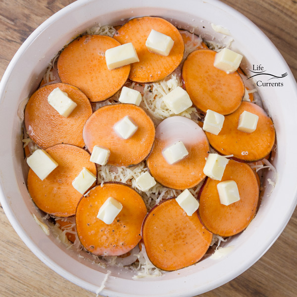Sweet Potato Layer Bake - all layers of are in, and the casserole is topped with butter
