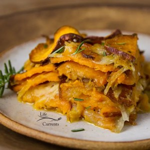 Sweet Potato Layer Bake - Sliced sweet potatoes are layered with onions and a light creamy cheese sauce, then this skinny side dish is baked up so the veggies are tender and delicious