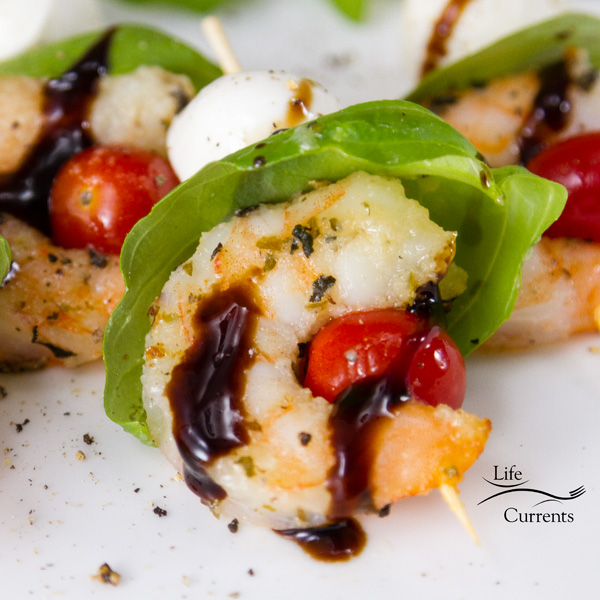Then, these Shrimp Caprese Skewers come together easily, just line up your ingredients and skewer them on some fun party skewers. Drizzle some glaze on top. Now you have a delicious and easy party appetizer.