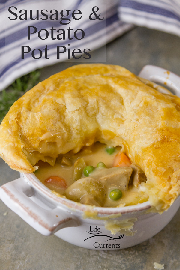 Sausage and Potato Pot Pie - These individual pot pies are simply delicious! A hearty sausage stew with earthy potatoes in a creamy delicious gravy all covered in flakey puff pastry.