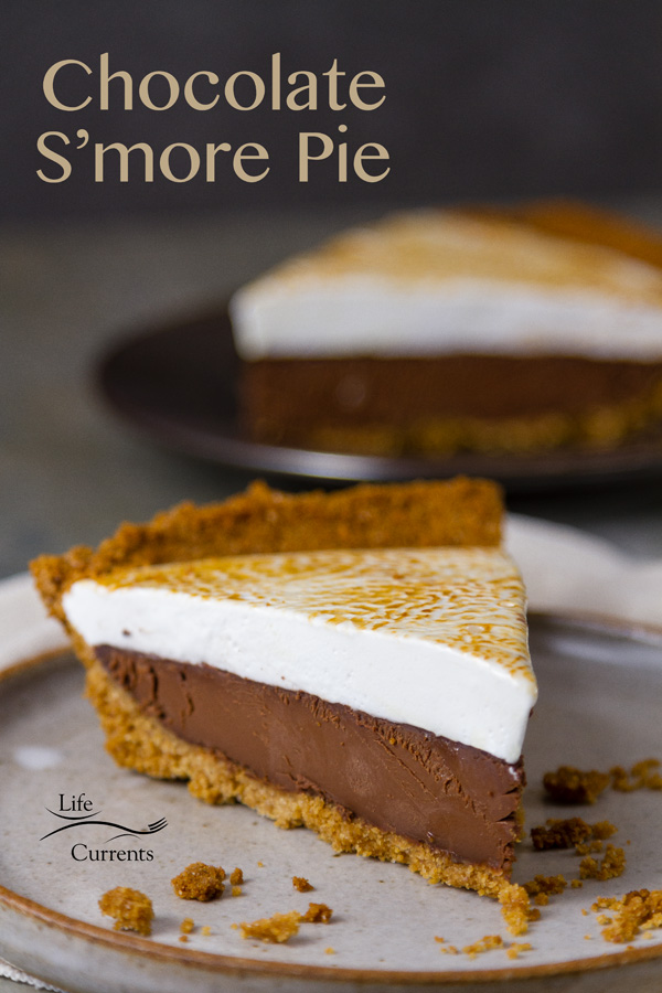 Chocolate S'More Pie  Freshly toasted homemade marshmallows top creamy delicious dark chocolate ganache all nestled in a golden graham cracker crumb crust. This pie makes it impossible to resist a slice, or maybe two.