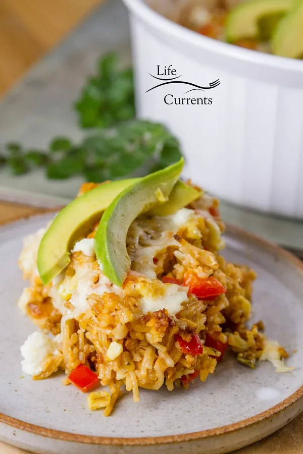 Cheesy Spanish Rice Casserole Quick and easy 30 minute meal I had a box of  Spanish rice mix in the cupboard one day and decided to gussy it up a bit for dinner. Making it a whole meal in one dish.
