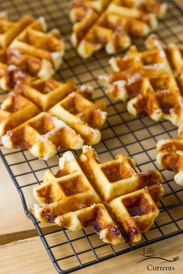 Belgian Liège Waffles Recipe – crispy bits of dough, pockets of perfect pearl sugar candy pieces, some of which have caramelized into indulgent delicious dessert treats!