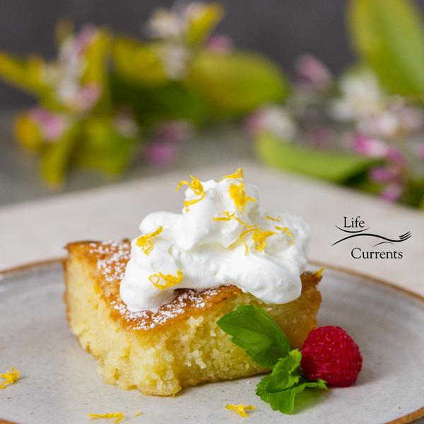 Lemon Cake on a plate with raspberries