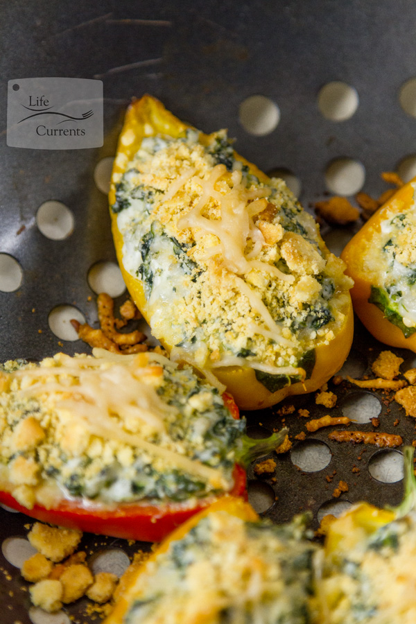 Grilled Cheesy Spinach Dip Stuffed Peppers - Super easy to make, and really fun to eat, these will be the life of the party!