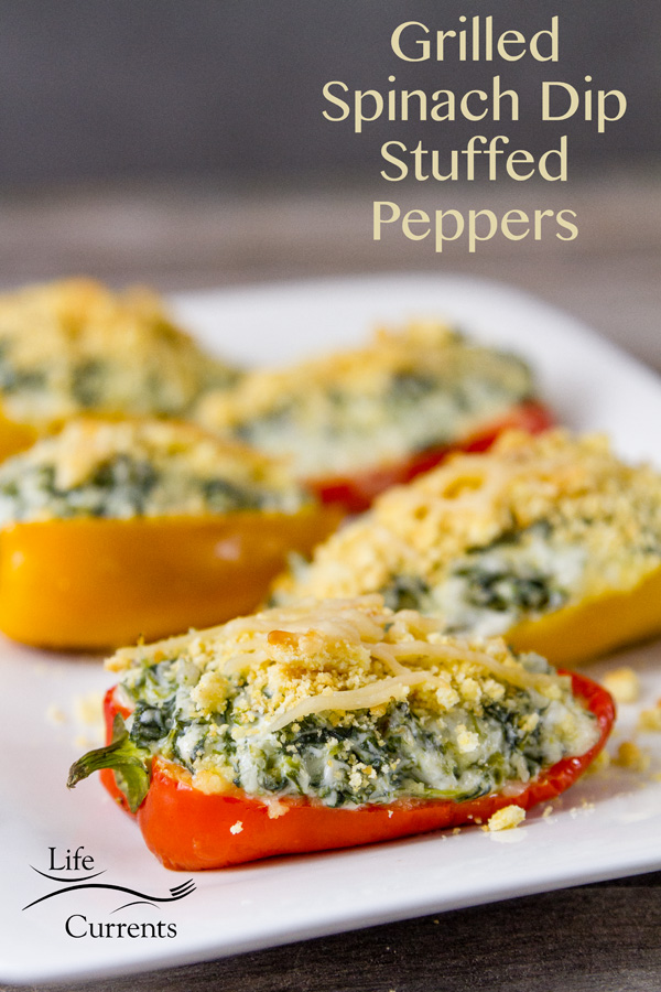 Grilled Cheesy Spinach Dip Stuffed Peppers Recipe made on the grill to golden brown perfection and served on a white plate
