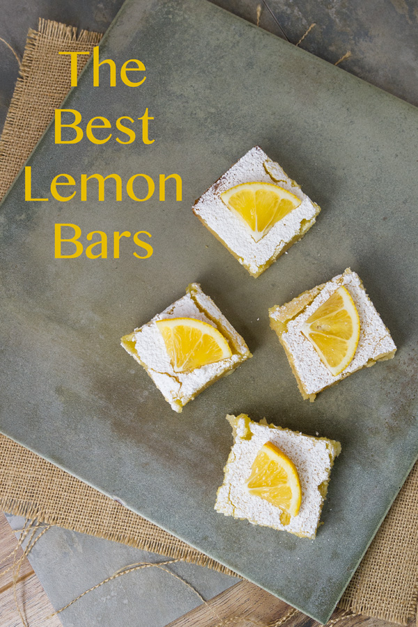 Lemon bars with a crumbly crust topped with a sweet-tangy lemony topping. Not too sweet, and not too tart. These are just right.